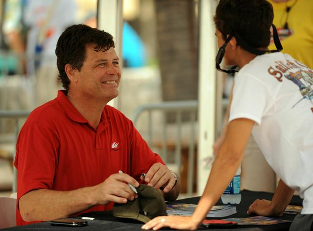 Michael Waltrip signs autographs for fans during the Coca-Cola Fuels NASCAR Championship Drive on Miami Beach on November 18, 2010. Marc Serota / Getty Images for NASCAR